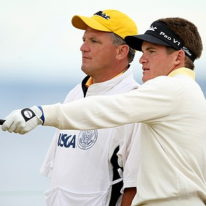 John Hahn talks with his caddie during the Round of 32. Hahn defeated Arnond Vongvanij 5 & 4 to advance to round of 16.