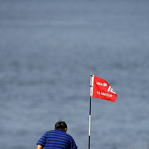 Byeong-Hun An picks up his tee shot just inches away from the hole at No. 15 during the Round of 32, he defeated Alex Shi Yup Kim 4 & 3.