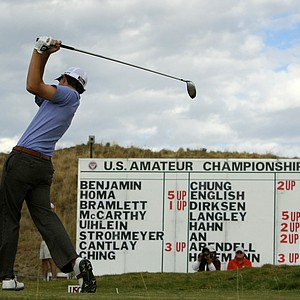 Patrick Cantlay hits his tee shot at No. 12 as the match play score board looms large in the background on Thursday.