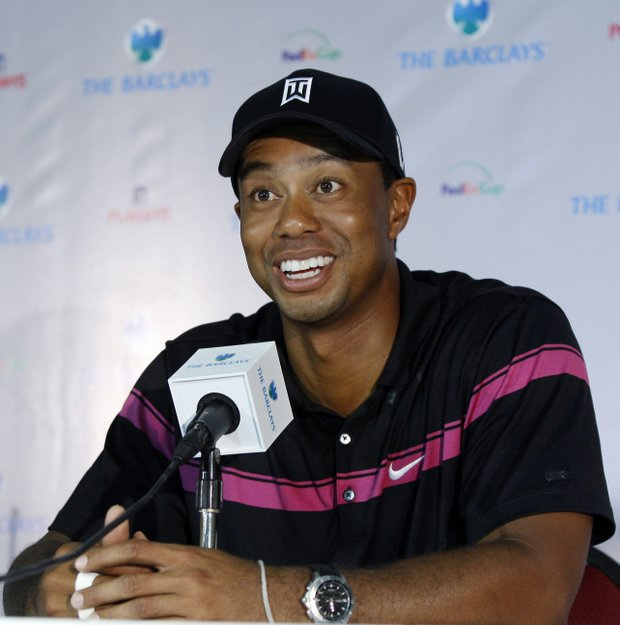 Tiger Woods chats with the media after shooting 65 in the first round of The Barclays.