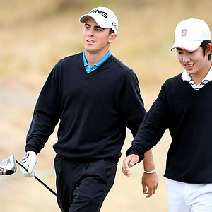 Scott Langley, left, and David Chung, right, leave No. 6 tee box during quarterfinals.