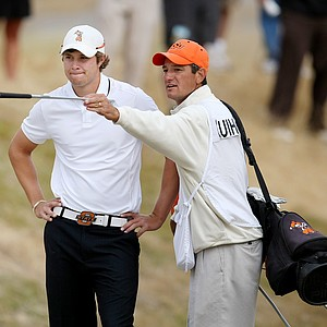 Alan Bratton, right, Peter Uihlein's caddie and college coach at Okalahoma State, chat  during quarterfinals.