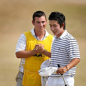 David Chung and his caddie after they defeated Scott Langley 1 up to advance to the semi finals.