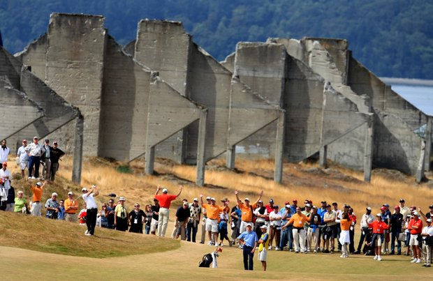 A crowd follows Peter Uihlein and Morgan Hoffmann at No. 18 past the sorting bins from when the area used to be a gravel mine operation.