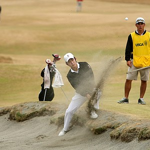 David Chung takes an odd stance to hit out of the bunker at No. 6.