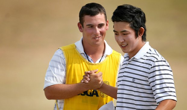 David Chung celebrates with his caddie after making birdie at No. 18 to defeat Scott Langley and advance to the semifinals at the U.S. Amateur.