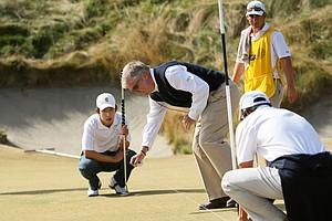David Chung waits at No. 10 as USGA's Thomas J. O'Toole Jr. measures to see who's away.