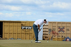 David Chung reacts to missing his putt at No. 17 as a train passes in the background.