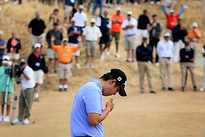 Byeong-Hun An drops his putter at No. 18 after missing his putt and losing to David Chung.