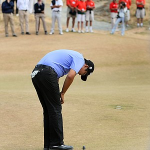Byeong-Hun An reacts to his semifinal loss to David Chung at the 18th green.