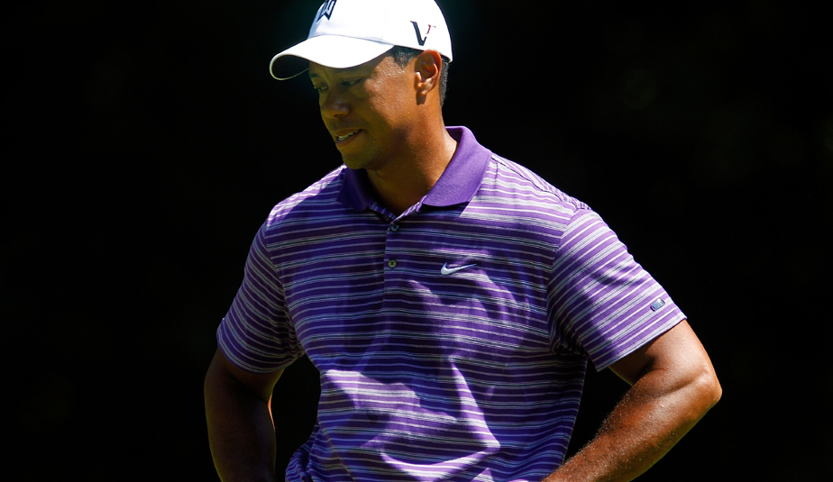Tiger Woods stands with his head down on the third tee box during the third round of The Barclays.