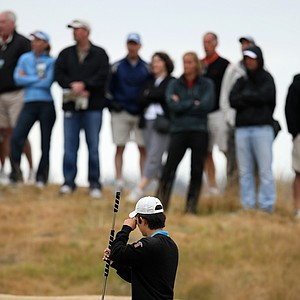 David Chung tries to get a better look at his line at No. 4 during the first 18 holes.
