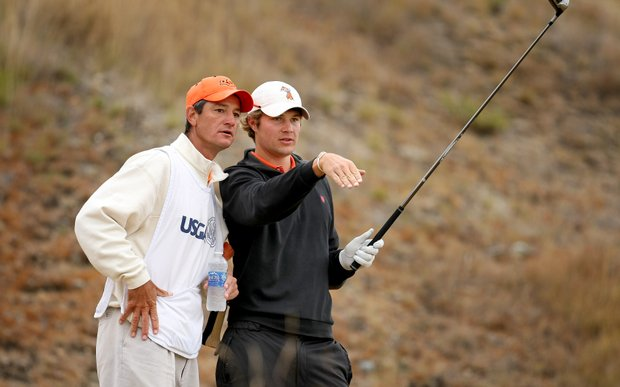Peter Uihlein, right, with his Oklahoma State caddie/coach Alan Bratton, at No. 5 during the first 18.