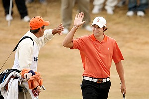 Peter Uihlein chips in for eagle at No. 18 and celebrates with his caddie Alan Bratton during the first 18 holes of the finals.