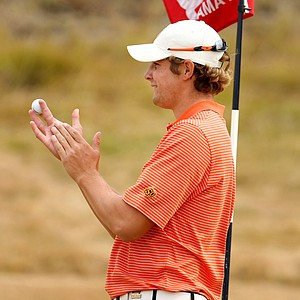 Peter Uihlein holds David Chung's ball and applaudes Chung's hole out at No. 8.