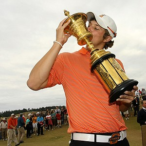 Peter Uihlein kisses the Havemeyer Trophy after winning the U.S. Amateur. Uihlein's win earned the world's top-ranked amateur spots in the Masters, U.S. Open and British Open.