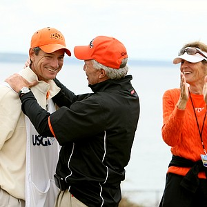 Alan Bratton, Peter Uihlein's caddie/Oklahoma State assistant golf coach, gets a hug from Peter's dad, Wally, after they defeated David Chung, 4 & 2.