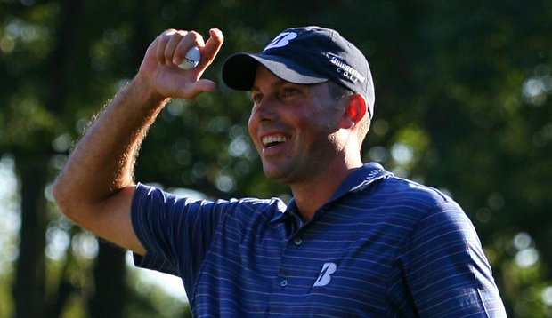Matt Kuchar celebrates after winning The Barclays in a playoff over Martin Laird.