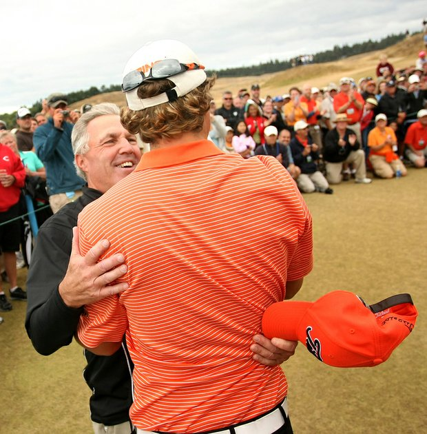 Wally Uihlein (left) celebrates with his son, Peter, winner of the 2010 U.S. Amateur.