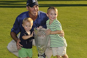 Matt Kuchar poses with sons Carson and Cameron after winning The Barclays.