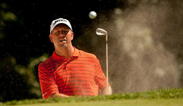 Mike Small follows through on a bunker shot during the second round of the John Deere Classic.