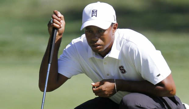 Tiger Woods reads a putt during the third round of the Deutsche Bank Championship.
