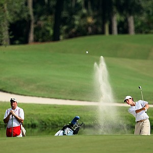 Michael Johnson hits out of a bunker at No. 2 during the final round.