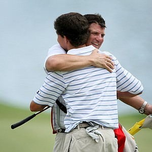 Caddie Mike Keeble and Michael Johnson hug after Johnson won the Junior Players at TPC Sawgrass.
