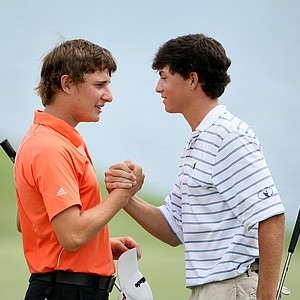 Emiliano Grillo, left, congratulates Michael Johnson after the final round of the Junior Players. Grillo tied for second behind Johnson.