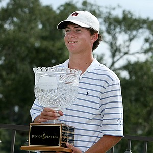 Michael Johnson poses with the trophy after winning the Junior Players at TPC Sawgrass.
