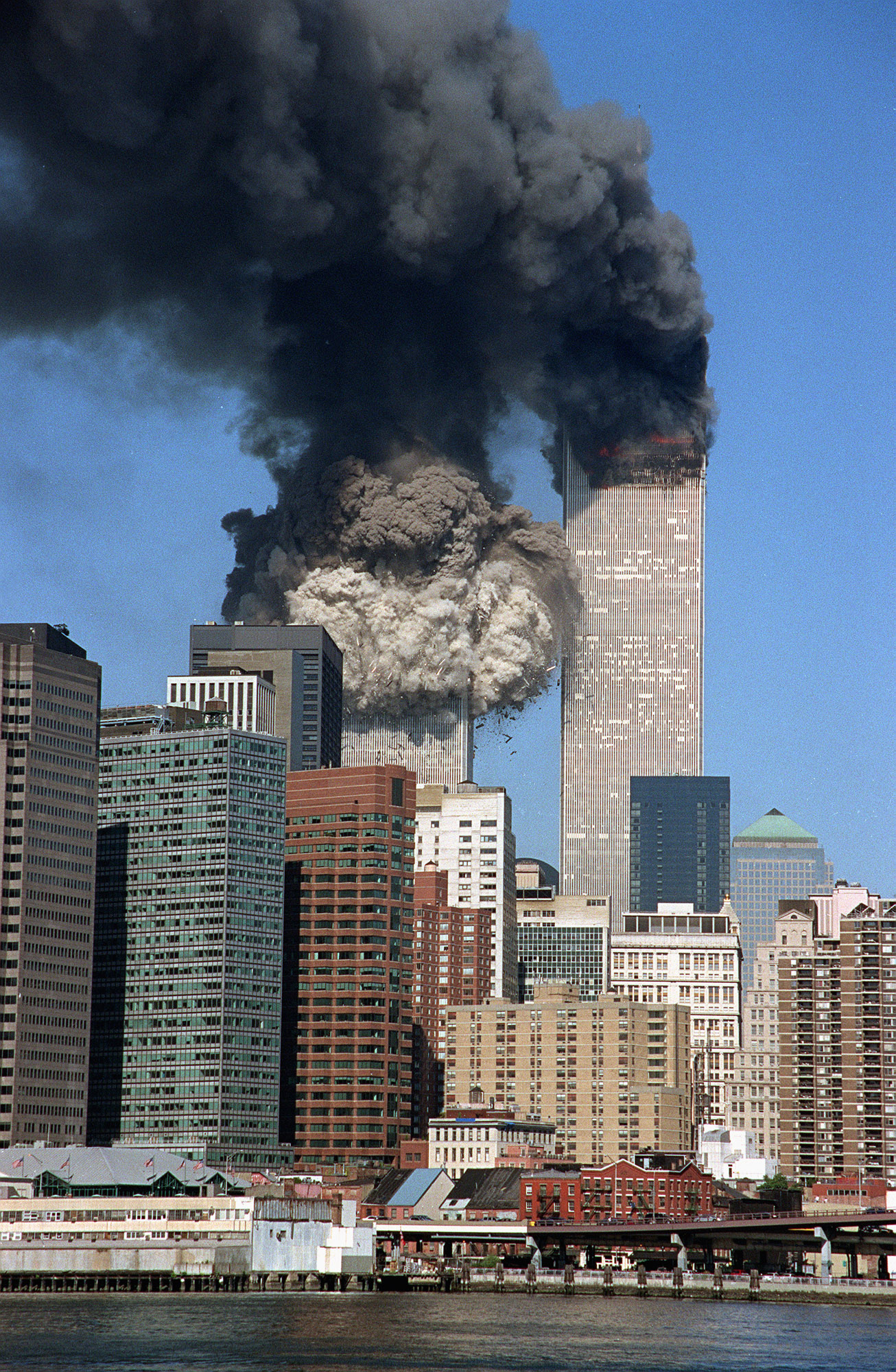 The South Tower collapses as smoke billows from the World Trade Center.