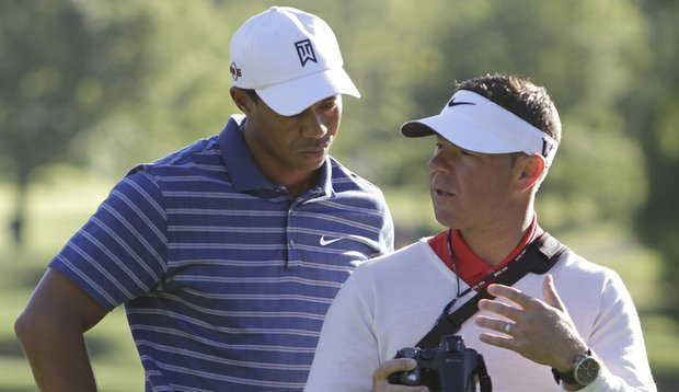 Tiger Woods and swing coach Sean Foley work together at the BMW Championship.