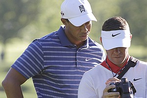Tiger Woods and swing coach Sean Foley watch Tiger's swing video at the 2010 BMW Championship on Sept. 8, 2010.