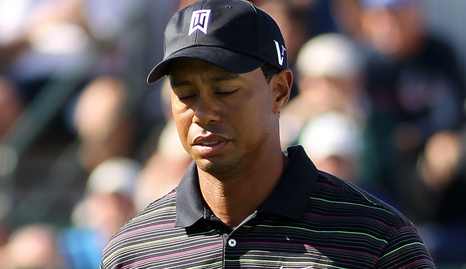 Tiger Woods reacts to his tee shot at the 12th hole during Round 2 of the BMW Championship.