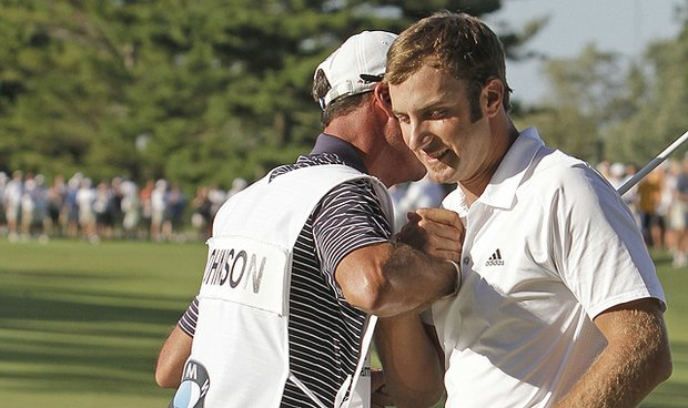 Dustin Johnson celebrates with his caddie Bobby Brown after winning the BMW Championship on Sept. 12, 2010.