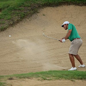 John McCarthy of Skidmore College hits out of a bunker at No. 18.