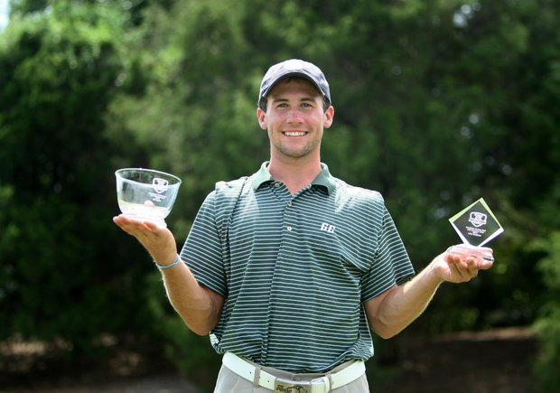 Brock Elder of Greensboro College with the individual title and and team title.