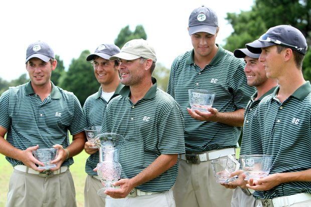 Greensboro head coach Dirk Fennie and his team after winning the Golfweek Division III Fall Invitational with a three round total of 858.