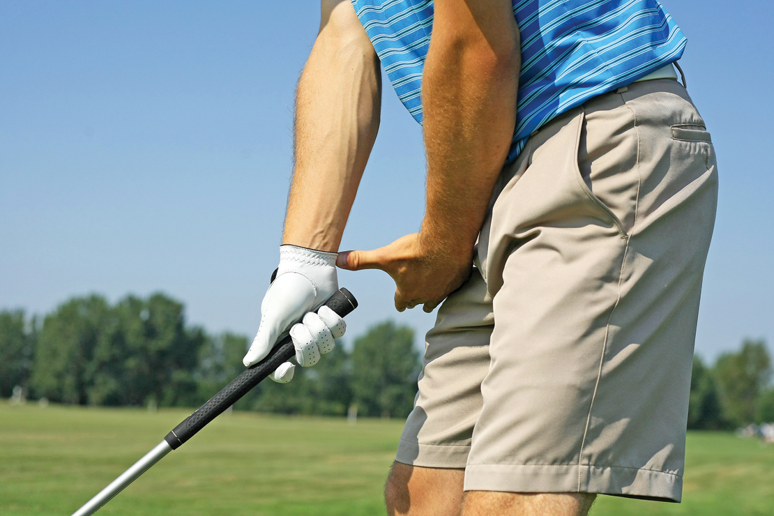 Langley uses his left hand to measure his position at address.