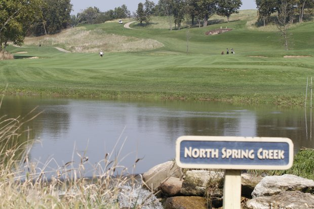 A creek remains swollen at Spirit Hollow Golf Course from heavy rain that fell before Round 1.