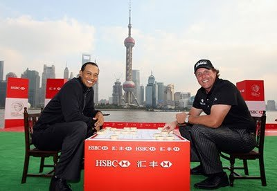 Tiger Woods and Phil Mickelson in Shanghai last year.