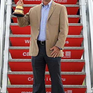 Corey Pavin stands with the Ryder Cup in Wales.