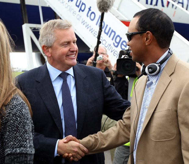 European captain Colin Montgomerie shakes hands with Tiger Woods.