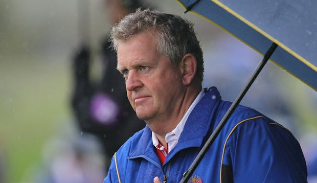 European captain Colin Montgomerie waits on the fourth hole as rain falls during the Friday morning four-ball matches.