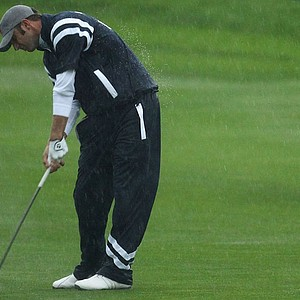 Dustin Johnson hits a shot during the downpour at the Ryder Cup.