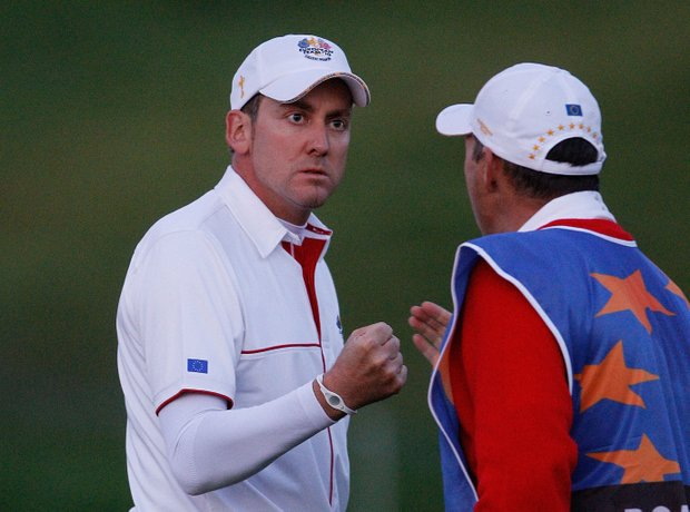 Ian Poulter of Europe celebrates on the 10th green with caddie Terry Mundy during the morning four-ball matches.