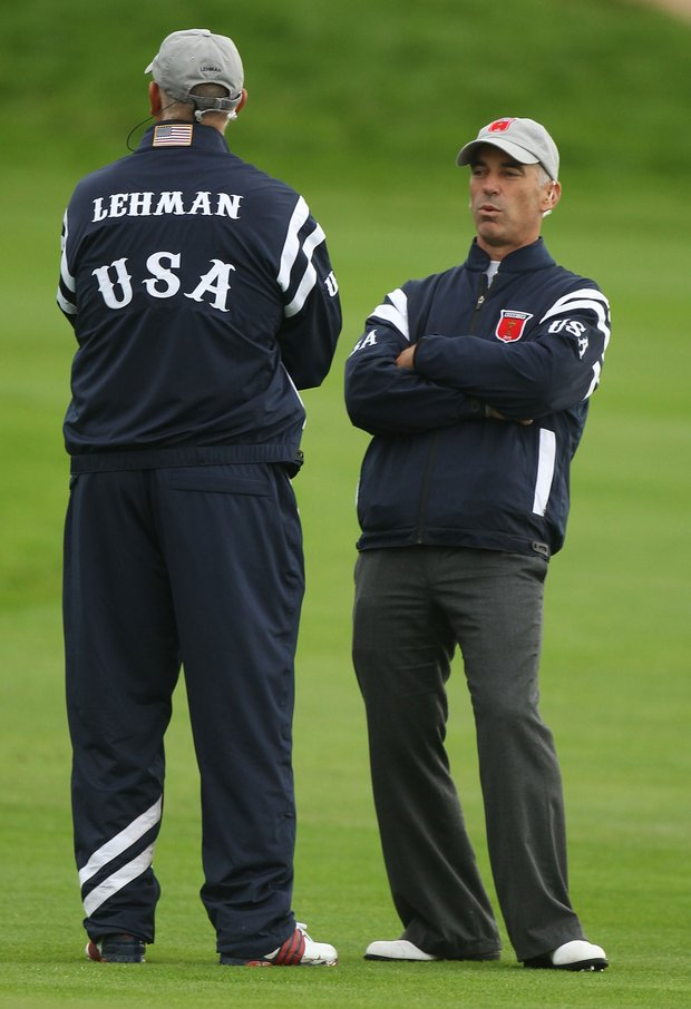 USA captain Corey Pavin chats with vice captain Tom Lehman during the morning four-ball matches.