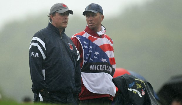 """Phil Mickelson and caddie Jim """"Bones"""" Mackay during the opening four-ball matches."""