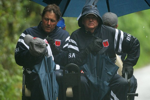 Phil Mickelson of the USA rides on a cart during the morning four-ball matches during the 2010 Ryder Cup.