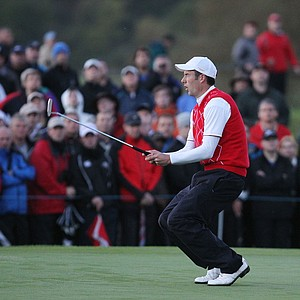 Ross Fisher of Europe reacts to a missed putt on the 10th green during the morning four-ball matches.
